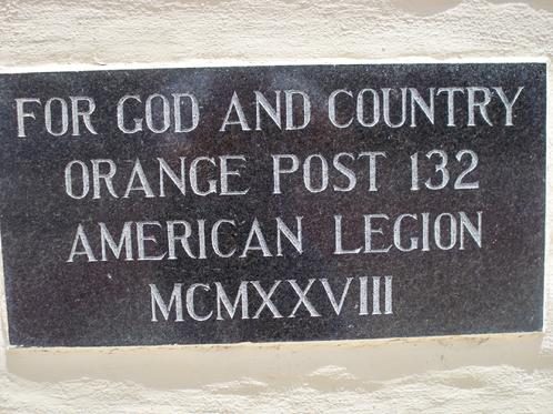 For God and County, motto at left corner of American Legion building